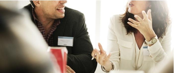 Image of employees talking
