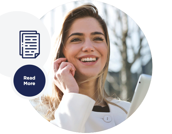 Image of a woman smiling while using a mobile phone.